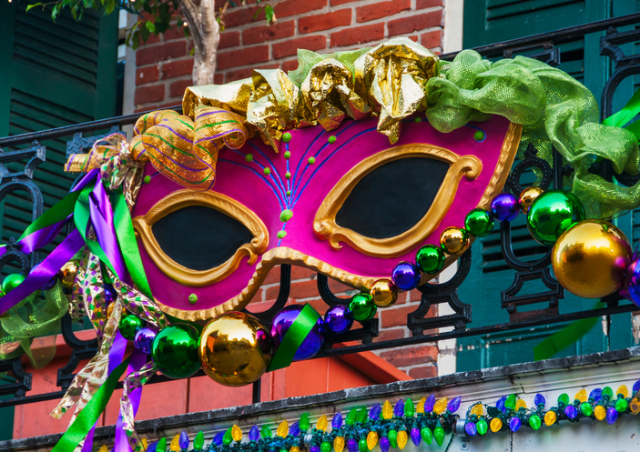 USA, New Orleans, Louisiana, Mardi Gras mask hanging on balcony's railing
